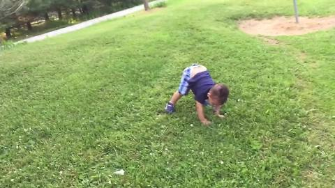 Little Boy Struggles To Stand Up