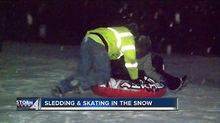 Southeast Wisconsin families have fun in the snow after dark - Video