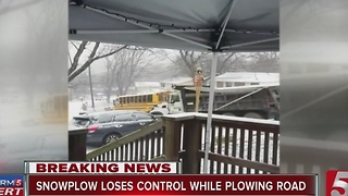 Plow Crashes While Trying To Help School Bus - Video