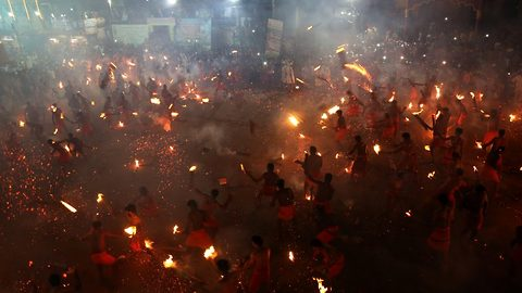 Bizarre festival: Torch-weidling men hurl burning leaves at each other to appease goddess