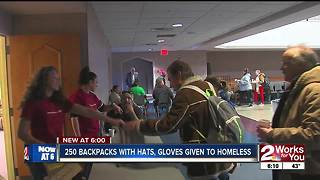 250 backpacks with hats, gloves given to homeless - Video