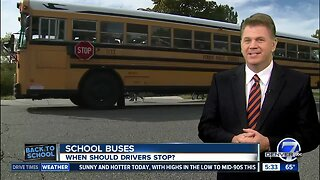When should you stop for a school bus?