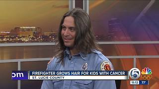 St. Lucie County firefighter grows hair for children fighting cancer - Video
