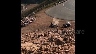 Biker takes hard tumble into rocks after losing control of motorcycle