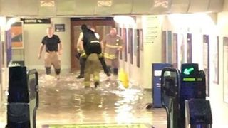 Firefighters Carry Commuters Out of Flooded Didcot Parkway Station - Video