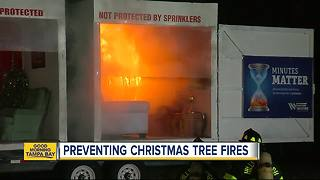 Fire department demonstrates the dangers of Christmas tree fires - Video