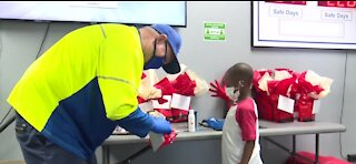 Little boy puts together thank you bags for sanitation workers