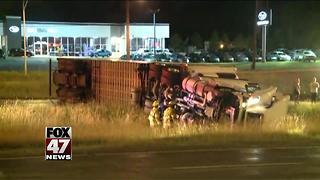 No one hurt in semi rollover accident - Video