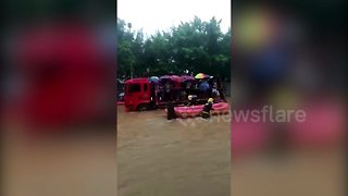Get me to the exam on time! Firefighters transport students through China floods