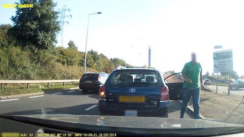 Enraged cabbie storms out of car in queueing traffic and launches foul-mouthed tirade at driver who beeped horn at him