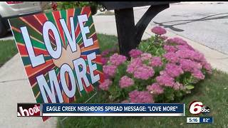 Woman hands out 'love more' signs in Indianapolis neighborhood - Video