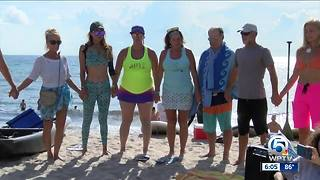 "Paddle out ceremony held for ""Ace"" in Delray Beach"