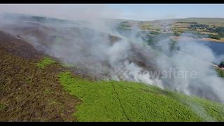 Drone footage shows major fire on Winter Hill, Lancashire - Video