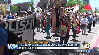 10 arrested at immigration protest - Video