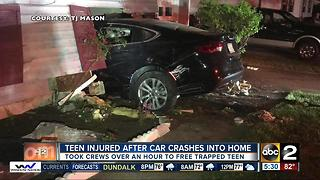 Teen rescued after car crashes into Aberdeen home - Video