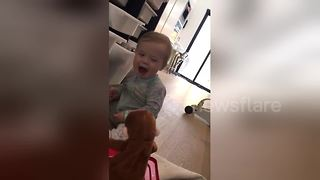 Baby gets terrified by Jack-in-the-box - Video