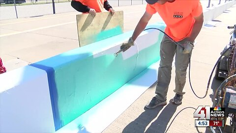 Kansas Speedway paints pit wall for cancer awareness