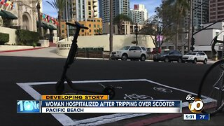 Woman hospitalized after tripping over scooter