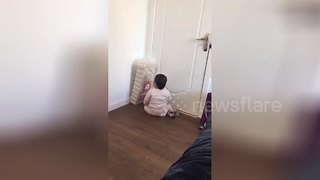 Toddler fights pack of toilet rolls - Video