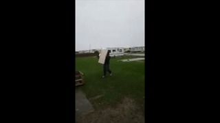 Storm Doris Sends Lad Tumbling to the Ground - Video