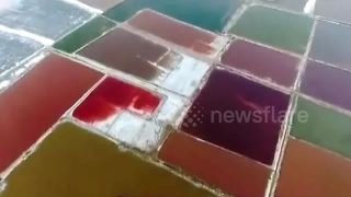 Aerial footage of colourful salt lake in northern China - Video