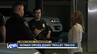 Woman drives drunk on trolley tracks - Video
