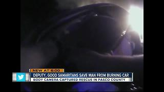 Deputy, good samaritans save man from burning car - Video