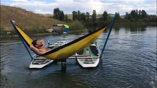 Man Chills Out on Hammock in the Middle of Peaceful Lake - Video