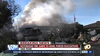 RV fire spreads to home, forces evacuations - Video