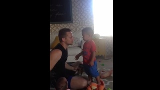 Kid freaks out when he see dad