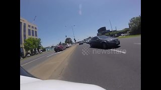 Motorbike sent onto opposite traffic lane after collision with car - Video