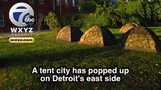 Group erects tent city for Detroit homeless on city's east side - Video