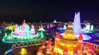 China's neon-lit ice city revealed at annual winter festival - Video