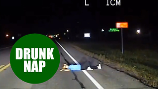 "Dashcam reveals moment police discover an ""intoxicated"" woman taking a nap - in the road"