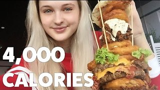 Competitive Eater Destroys 4,000 Calorie Burger - Video