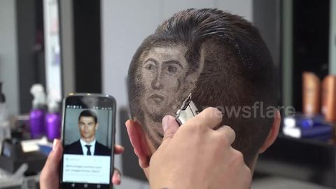 This Bogota barber will style headshots of your favourite World Cup player into your hair