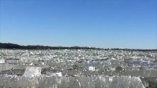 Mesmerising footage of ice waves breaking on frozen lake - Video