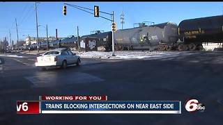 Indy residents upset over trains stopped on tracks, blocking roads - Video