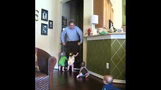 Happy Quadruplets Preciously Crawl Towards Greeting Their Father - Video