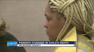 Parents charged in 9-year-old daughter's death - Video