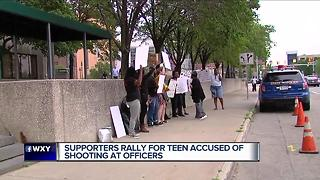 Supporters rally for teen accused of shooting at officers - Video