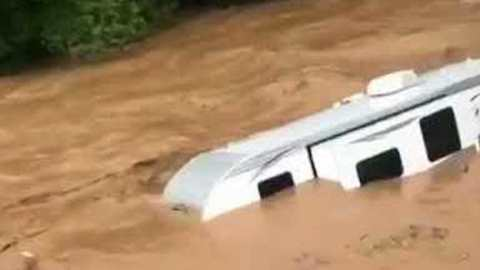 Camper Floats Down Flooded Pennsylvania Creek