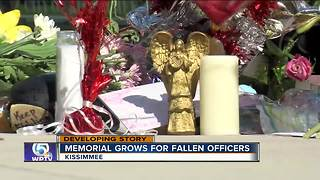 Memorials form for fallen Kissimmee police officers - Video