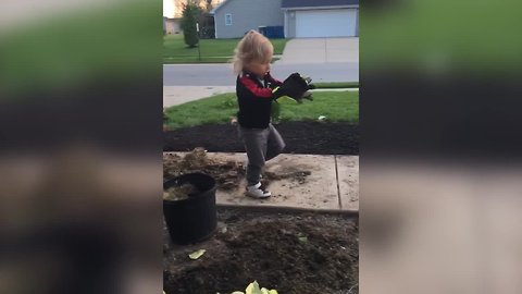 Funny Tot Boy Helps His Mom With Gardening