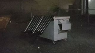 Storm Winds Push Dumpsters Across Yard in Tulsa - Video