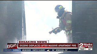 Dozens displaced after massive apartment fire