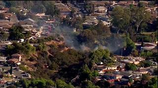 Fire burns dangerously close to homes in canyon