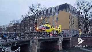 Helicopter lands on Amsterdam Canal - Video