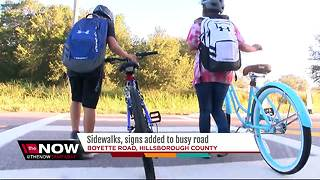 Sidewalks, signs added to busy Boyette Road - Video