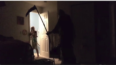 Dad scares daughter to tears with Grim Reaper prank